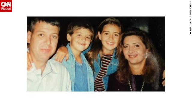 Nicole Eisenschenk, in the striped shirt, is pictured with her family in 1993. They lived in Dallas, Texas.