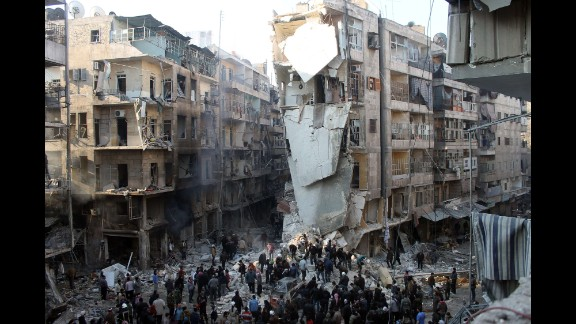 People search for survivors amid the rubble after an airstrike in Aleppo on Tuesday, December 17.