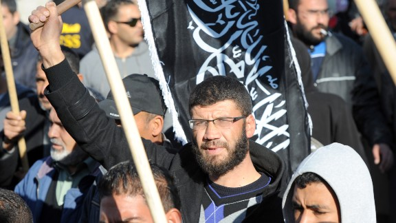 Members of Tunisian Islamic group Hizb-ut-Tahrir gather in Mohamed Bouazizi square to mark the third anniversary of the uprising that toppled President Zine el Abidine Ben Ali on December 17, 2013. The square was named after the fruit seller whose self-immolation sparked the revolution that ousted the long-standing ruler and ignited the Arab Spring.