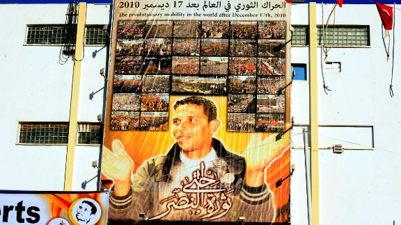 A giant portrait of Mohamed Bouazizi hangs on the wall in the central town of Sidi Bouzid. The 26-year old fruit seller who struggled with poverty set himself on fire in front of a government building on December 17, 2010 sparking riots across the country. Al Bouazizi died of his injuries on January 4, 2011.