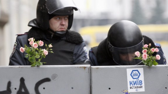 Flowers are stuck on barriers in front of Ukrainian Interior forces guarding Kiev