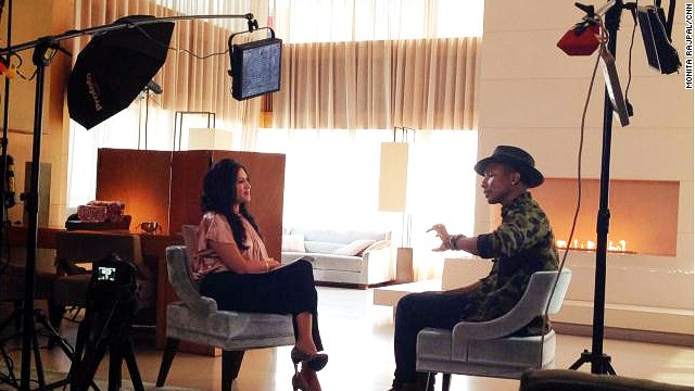 Talk Asia host Monita Rajpal and guest, Pharrell Williams on set.