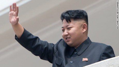 North Korean leader Kim Jong-Un waves to the crowd during a military parade at Kim Il-Sung square marking the 60th anniversary of the Korean war armistice in Pyongyang on July 27, 2013. North Korea mounted its largest ever military parade on July 27 to mark the 60th anniversary of the armistice that ended fighting in the Korean War, displaying its long-range missiles at a ceremony presided over by leader Kim Jong-Un. AFP PHOTO / Ed Jones (Photo credit should read Ed Jones/AFP/Getty Images)