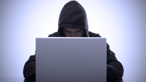 With big data comes big responsibility. Above, a computer hacker types on his laptop representing the ominous future of data protection and security.