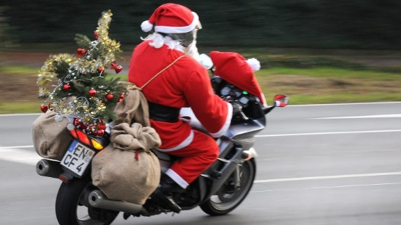 A man dressed as Santa Claus drives his motorcycle in Bochum, Germany, on December 18.