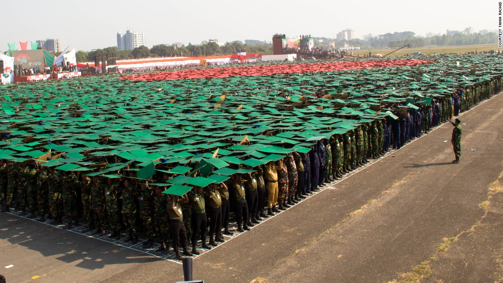 Students and army officials hold green and red placards to create the Bangladeshi flag, which was adopted in 1972 after Bangladesh gained independence.