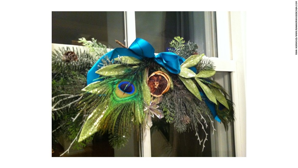 Peacock feathers and cut pine and cedar helped Norwood focus her holiday decor on blues and greens.