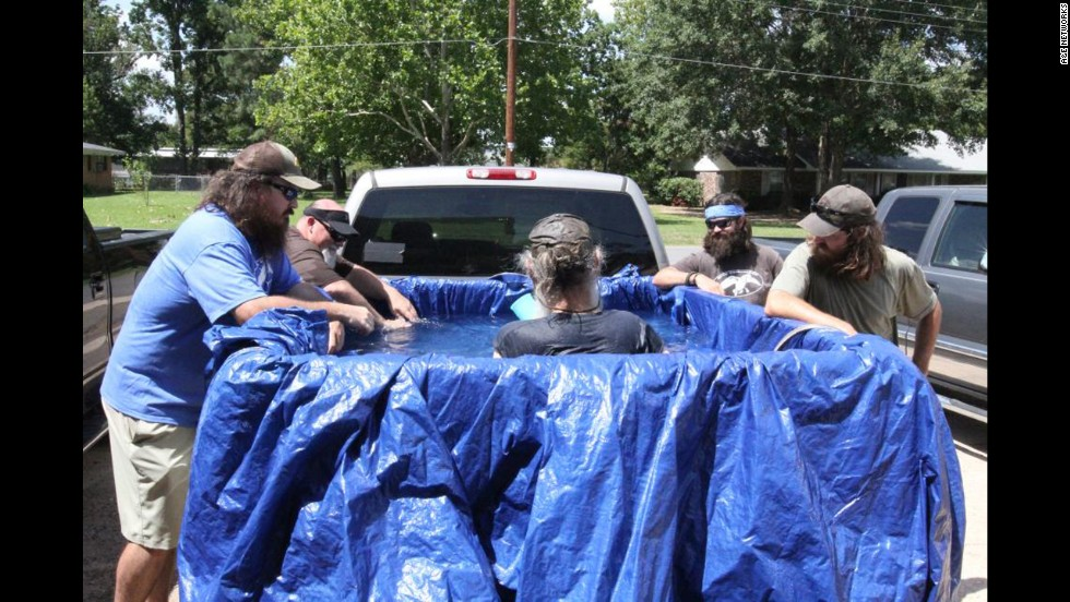 "In a ""Duck Dynasty"" episode where the office air conditioning broke, Si tries to beat the heat by creating a pool in the back of his pickup truck."