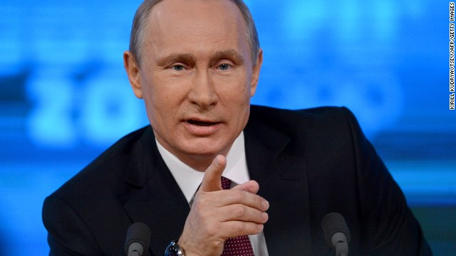 Russia's President Vladimir Putin speaks during his annual press conference in Moscow on December 19, 2013.