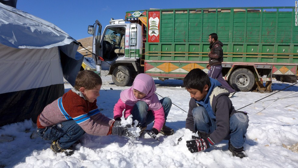 Syrian refugees play in the snow at the Shuhada Camp in Arsal, Lebanon on December 16. Impoverished Syrian refugees throughout the Middle East are facing harsh winter weather.
