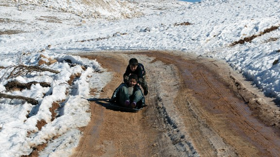 Children play in the snow at a refugee camp in Arsal on December 15.