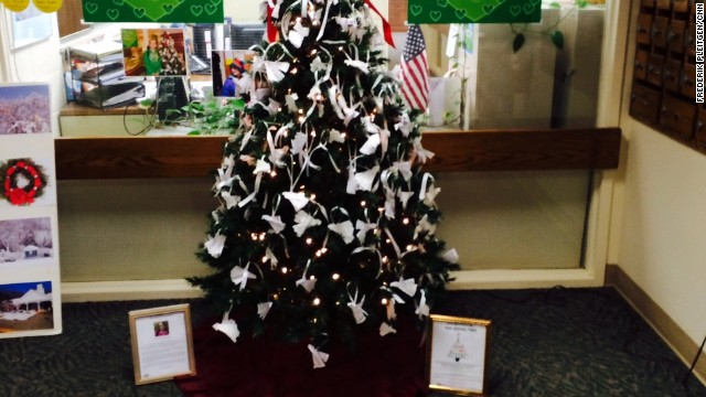 "Chelsea's ""giving tree"" at the Oxford, Connecticut, Town Hall allows her donors to hang paper doves with their names."