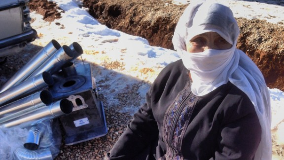 Um Bassam, a 70 year old refugee from Syria, is one of the recipients of a stove for heating that was distributed by the UNHCR in Arsal, Lebanon.