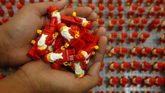 Women organize thousands of Lego Santa Clauses on Wednesday, December 18, in Surabaya, Indonesia.