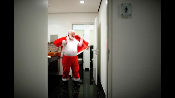 Axel Richter prepares himself for the role of Santa Claus on Thursday, December 19, in Hanover, Germany. Richter starts growing his beard out in August to be sure it's long enough by Christmas when he visits nine families and brings presents to the children, reads them poems and celebrates Christmas with them.