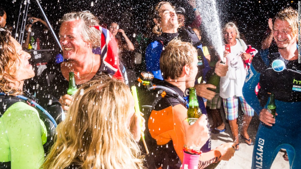 A well deserved spraying of the traditional champagne awaited the team and its helpers on arrival.