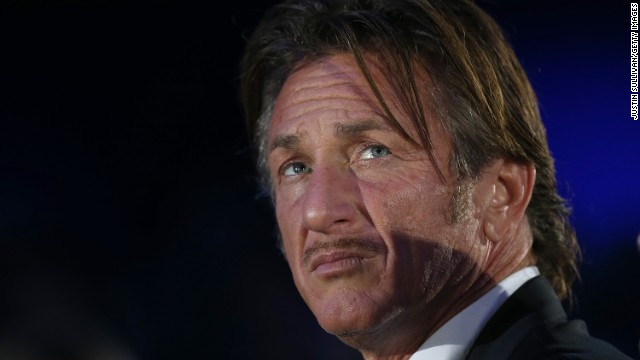 Actor Sean Penn looks on during a keynote address by Salesforce chairman and CEO Marc Benioff at the 2013 Dreamforce conference on November 19, 2013 in San Francisco, California. T