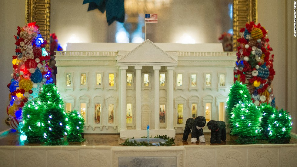 A 300-pound gingerbread White House stands among the decorations in the State Dining Room on December 4.