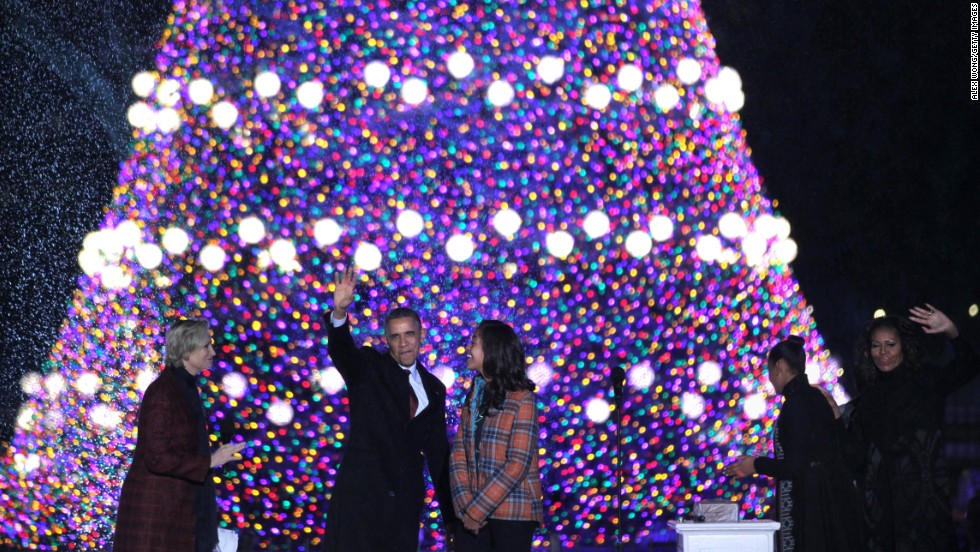 President Barack Obama and first lady Michelle Obama, and daughters Sasha and Malia, participate in the lighting ceremony of the National Christmas Tree as actress and host Jane Lynch, left, looks on during a ceremony at the Ellipse on Friday, December 6.