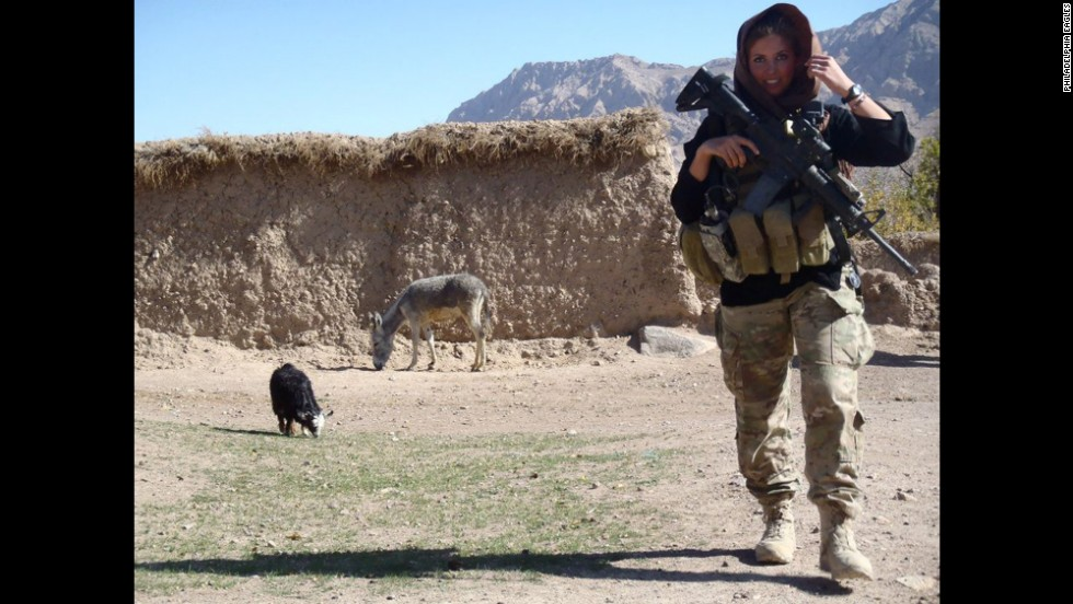 U.S. Army 1st Lt. Rachel Washburn walks through a village while serving one of two military tours in Afghanistan. Washburn is a Bronze Star recipient and a former Philadelphia Eagles NFL cheerleader from 2007 to 2009. Washburn, who was raised in a military family, is a graduate of Drexel University in Philadelphia.