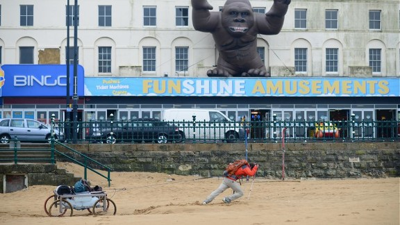 The pair prepared for their trip by dragging the cart across the wet sands of the English seaside town of Margate.