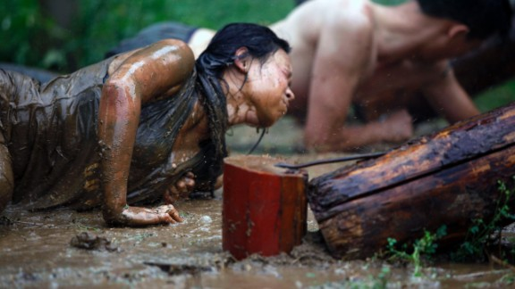 Trainees must crawl through mud and undergo other endurance training.