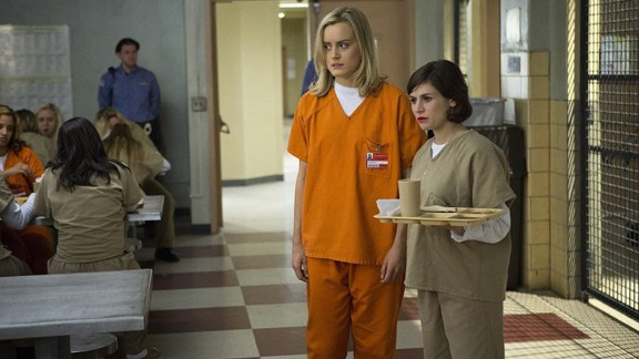 """""""Orange Is the New Black"""": Critics have hailed Netflix's """"Orange Is the New Black"""" as one of their favorite shows of 2014, and with good reason. The premise doesn't sound funny -- a middle-class woman is sent to a prison filled with some rather unique inmates -- but the dark comedy from """"Weeds"""" creator Jenji Kohan has as much humor as it does heart. Even better, the second season is just as rich and binge-worthy as the first."""
