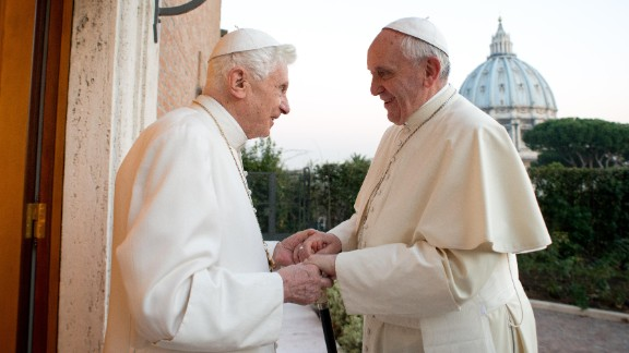 "Pope Francis meets with Pope Emeritus Benedict XVI at the Vatican in December 2013. Benedict surprised the world by resigning ""because of advanced age."" It was the first time a pope has stepped down in nearly 600 years."