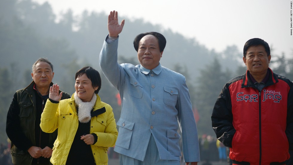 An actor playing China's former leader Mao Zedong waves as people gather in China's central province of Hunan on December 24 to celebrate Mao's 120th anniversary today. These photos show how the country prepares to commemorate his birthday and how he is remembered in China.