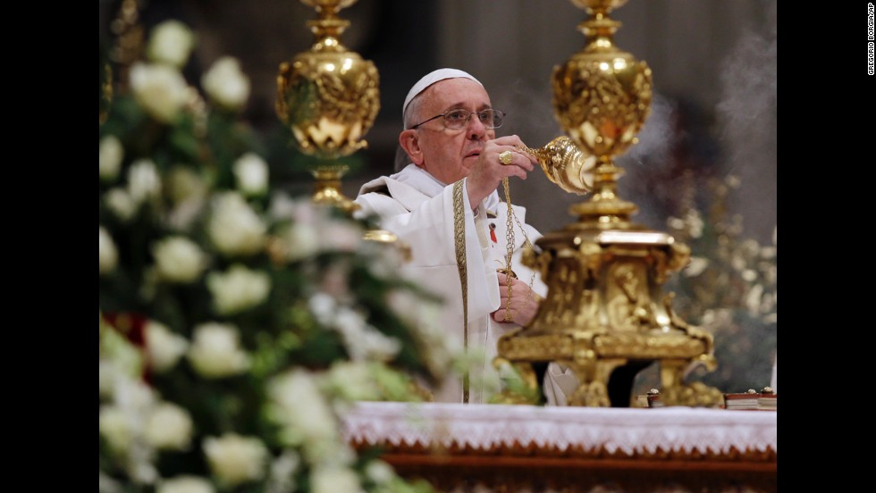 The Pope waves incense during the celebration.