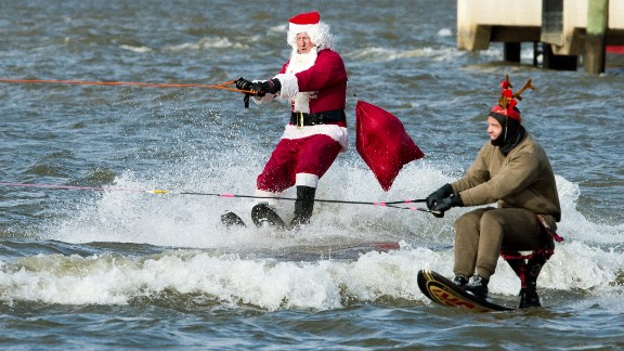 A water-skiing Santa Clause and a reindeer head down the Potomac River at National Harbor, Maryland, on December 24.