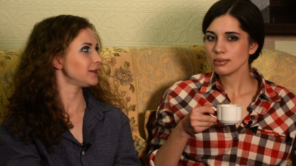 Two members of anti-Kremlin punk band Pussy Riot, Nadezhda Tolokonnikova (R) and Maria Alyokhina speak with journalists at hotel in the Siberian city of Krasnoyarsk, some 3500 km (2174 miles) east of Moscow, on December 24, 2013. The two jailed members of anti-Kremlin punk band Pussy Riot, whose imprisonment prompted a wave of global outrage, walked free yesterday and immediately vowed to fight injustice in Russian prisons. AFP PHOTO/VASILY MAXIMOV        (Photo credit should read VASILY MAXIMOV/AFP/Getty Images)