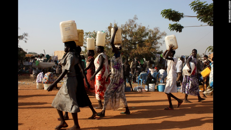South Sudanese women carry water at a U.N. camp in Juba on December 22.