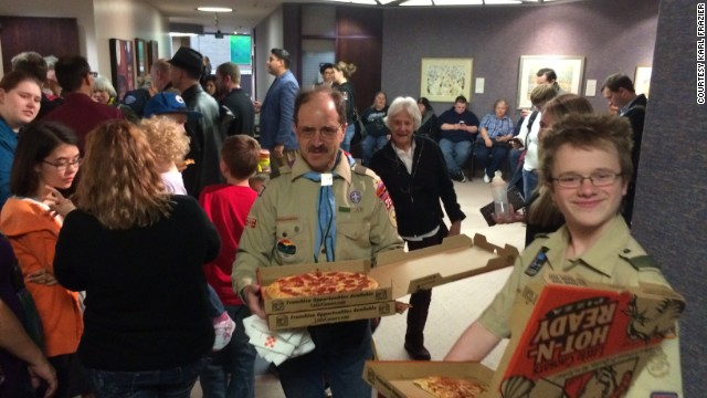 Peter Brownstein and his son deliver pizzas at the county clerk's office in Salt Lake City. He later wore a rainbow kerchief.