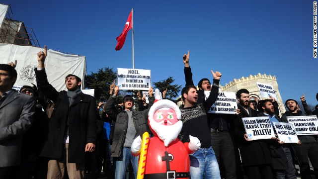 A Turkish Muslim group protests and hold signs reading 'Christmas is incompatible with Islam' during a demonstration in Istanbul on December 26.