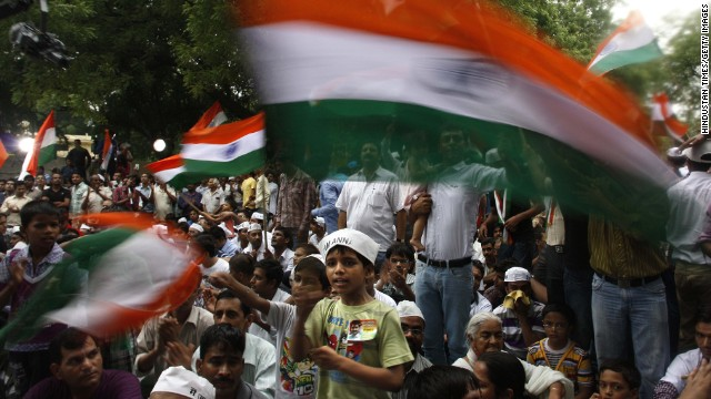 A boy waves the Indian flag during a hunger strike against corruption in New Delhi, India in 2012.