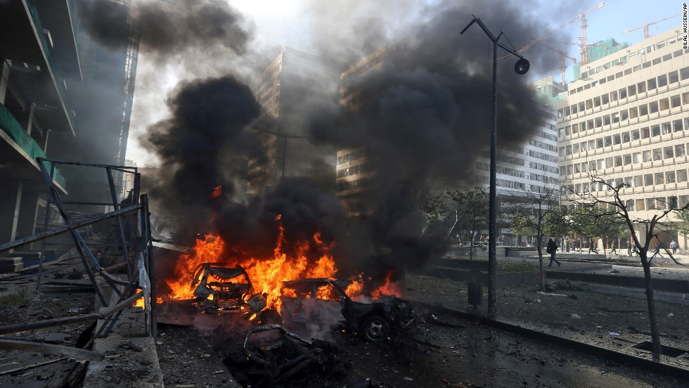 Flames pour from vehicles after an explosion in Beirut, Lebanon, on Friday, December 27. A car bombing shook the Lebanese capital, sending black smoke billowing a few hundred meters from the government headquarters and Parliament building.