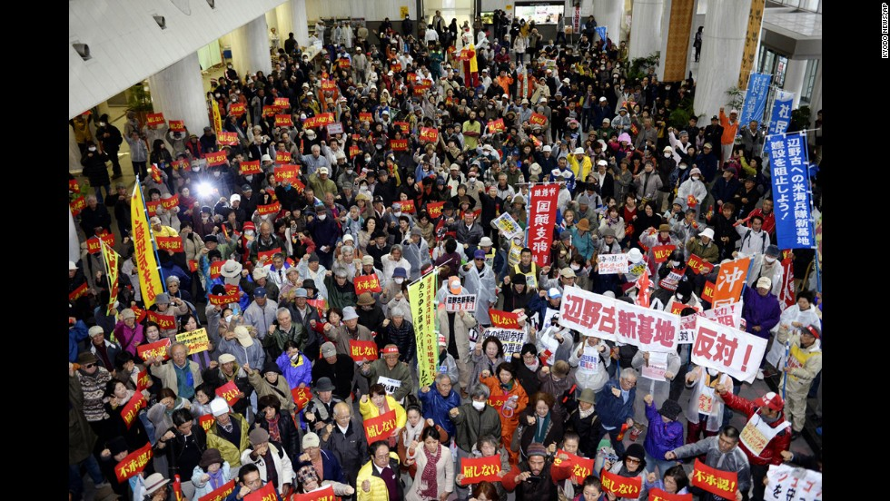 Hundreds of protesters stage a rally opposing the approval of the relocation in the lobby of Okinawa prefecture's government building in Naha on Friday, December 27. The Futenma air base, which is in a highly populated area, has been unpopular with the island's residents because of crimes committed by U.S. military personnel and allegations against them in the past.