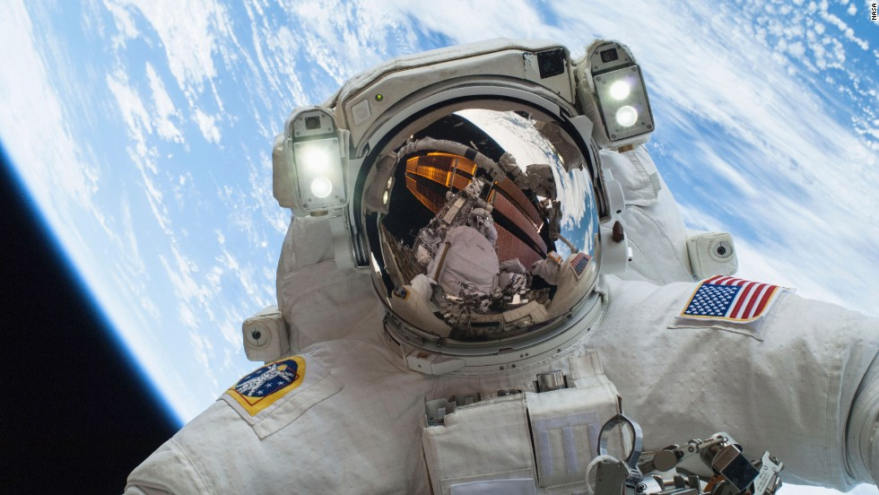 See astronauts on their first spacewalk
