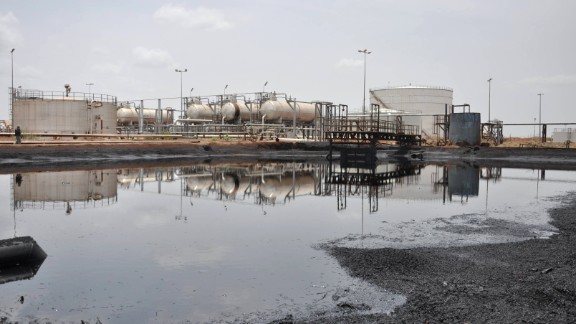 """(FILES)-- A file photo taken on April 23, 2012 shows a view of an oil field in Bentiu, South Sudan. South Sudan restarted oil production on April 6, 2013, ending a 15-month bitter row with former civil war foe Sudan and marking a major breakthrough in relations after bloody border clashes last year. """"The oil is now flowing, """" South Sudan oil minister Stephen Dhieu Dau shouted as he flicked a switch to restart production at a ceremony in the Thar Jath field in Unity state. AFP PHOTO / HANNAH MCNEISHHANNAH MCNEISH/AFP/Getty Images"""