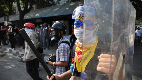 An anti-government protesters armed with a batton and riot shield takes part in violent protest.