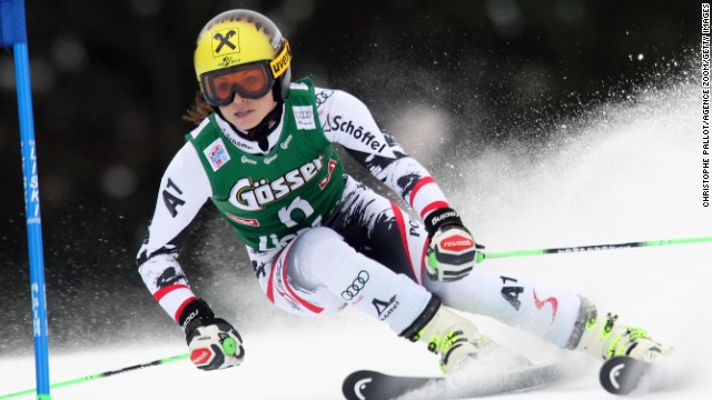 Anna Fenninger overturned a 0.02-second first run deficit to win a giant slalom at home in Austria.