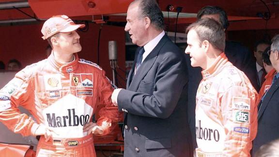 King Juan Carlos of Spain congratulates Schumacher after he won the Spanish Formula 1 Grand Prix in 2001.