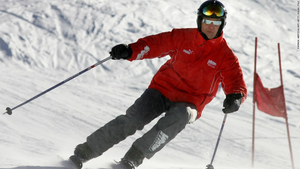 "Michael Schumacher navigates a slalom course at the Italian ski resort of Madonna di Campiglio in 2005. The seven-time Formula One world champion remains in a critical condition following a skiing accident in the French Alps on Sunday. The 44-year-old was reportedly wearing a helmet. Ski safety specialist Dr. Mike Langran says a helmet can never provide complete protection in all accident situations, but its use ""will have substantially attenuated the injuries sustained."" <br />"