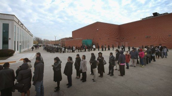 Job seekers attend a job fair in Chicago in 2012. When the doors opened at 9 a.m., the line was half a mile long.
