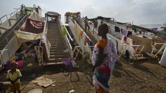 Moveable stairs used for passengers to board aircraft are repurposed into makeshift shelters at a U.N. compound in Juba on December 29.