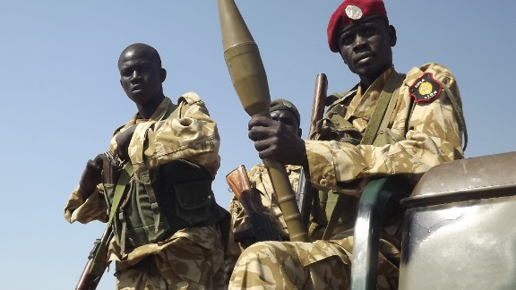 South Sudanese troops loyal to President Salva Kiir pictured at Bor airport after they re-captured it from rebel forces on December 25, 2013.