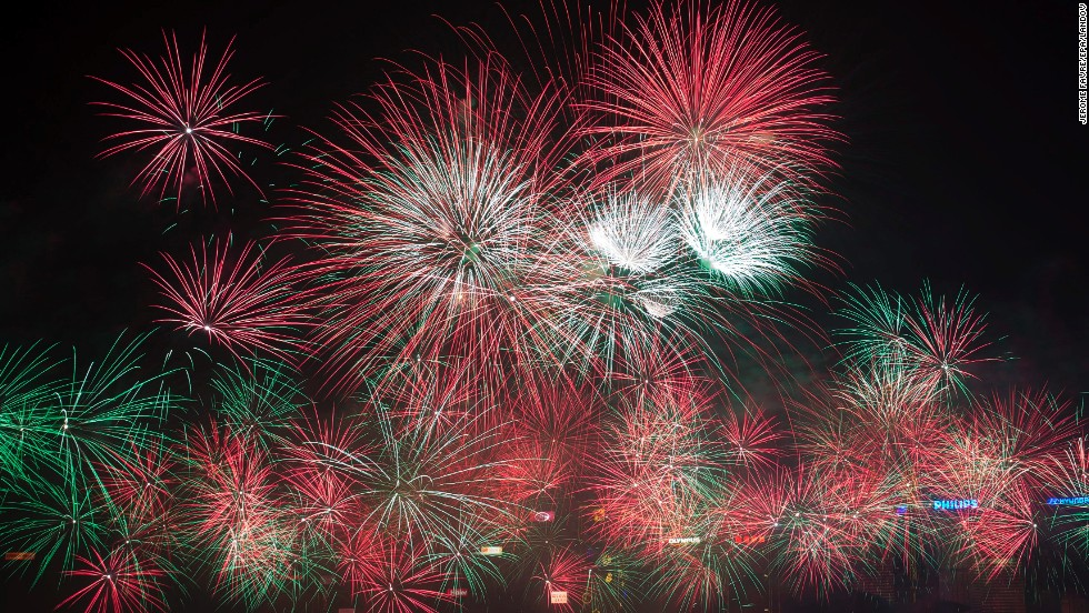 Fireworks are seen over Victoria Harbor in Hong Kong.