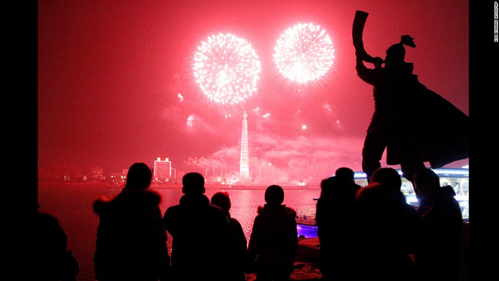 Fireworks explode over Juche Tower and the Taedong River in Pyongyang, North Korea.