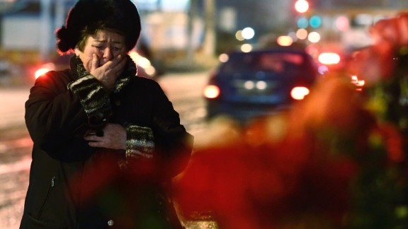 A woman cries outside a wreckage of a trolleybus that was attacked by a suicide bomber in Volgograd.